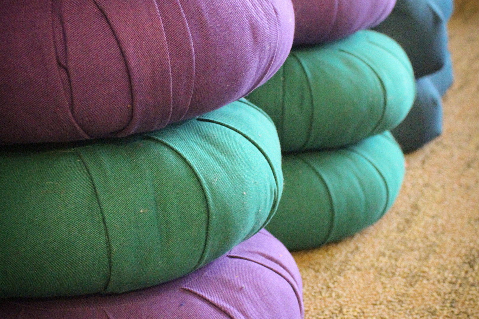 cropped_stacked cushions - floor yoga poses